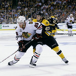 Boston Bruins defenseman Torey Krug (47) checks Chicago Blackhawks right wing Ben Smith (28) during the first period in Game 3 of the NHL hockey Stanley Cup Finals in Boston, Monday, June 17 …