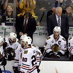 Chicago Blackhawks head coach Joel Quenneville, right, team captain Jonathan Toews (19) and their team pause during a break in pay in the third period in Game 3 of the NHL hockey Stanley Cup …