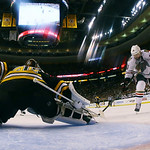 Chicago Blackhawks center Patrick Sharp (10) shoots against Boston Bruins goalie Tuukka Rask, left, of Finland, during the second period in Game 3 of the NHL hockey Stanley Cup Finals in Bos …