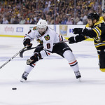 Boston Bruins defenseman Andrew Ference (21) defends against Chicago Blackhawks defenseman Nick Leddy (8) during the third period in Game 3 of the NHL hockey Stanley Cup Finals in Boston, Mo …