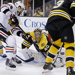Boston Bruins goalie Tuukka Rask (40), of Finland, stops an attempt by Chicago Blackhawks left wing Viktor Stalberg (25), of Sweden, during the third period in Game 3 of the NHL hockey Stanl …