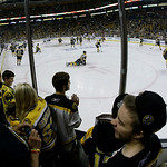 Boston Bruins fans watch their team during warm-ups before Game 3 of the NHL hockey Stanley Cup Finals against the Chicago Blackhawks in Boston, Monday, June 17, 2013. (AP Photo/Elise Amendo …