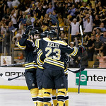 Boston Bruins center Chris Kelly (23) and celebrates a goal by Boston Bruins left wing Daniel Paille, hidden, during the second period in Game 3 of the NHL hockey Stanley Cup Finals against  …