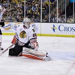 The puck from Boston Bruins' Daniel Paille, not seen, settles into the net past Chicago Blackhawks goalie Corey Crawford (50) and defenseman Michal Rozsival (32), of the Czech Republic, duri …