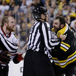 Chicago Blackhawks left wing Bryan Bickell, left, and Boston Bruins defenseman Zdeno Chara, right, of Slovakia, and are separated by officials during the third period in Game 3 of the NHL ho …