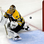 Boston Bruins goalie Tuukka Rask, of Finland, turns aside the puck shot by the Chicago Blackhawks during the second period in Game 3 of the NHL hockey Stanley Cup Finals in Boston, Monday, J …