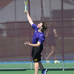 Avon's Spencer Yates serves Avon Lake during their second doubles championship round.