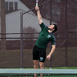 Westlake's Kent Dinchman serves in a first doubles match.