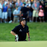Phil Mickelson runs to check on his shot on the 18th hole during the fourth round of the U.S. Open golf tournament at Merion Golf Club, Sunday, June 16, 2013, in Ardmore, Pa. (AP Photo/Julio …
