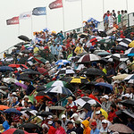 Spectators watch play from the 17th grandstand in a rainstorm during the fourth round of the U.S. Open golf tournament at Merion Golf Club, Sunday, June 16, 2013, in Ardmore, Pa. (AP Photo/G …