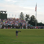 Phil Mickelson, lower right, watches his ball hit onto the 18th hole green during the final day of the U.S. Open golf tournament on Sunday, June 16, 2013, at Merion Golf Club in Ardmore, Pa. …