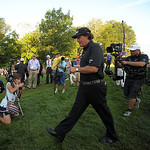 Phil Mickelson, center, makes his way to the 18th hole during the final day of the U.S. Open golf tournament on Sunday, June 16, 2013, at Merion Golf Club in Ardmore, Pa. (AP Photo/The Expre …