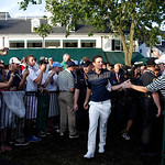 Justin Rose, of England, greets spectators after winning the U.S. Open golf tournament at Merion Golf Club, Sunday, June 16, 2013, in Ardmore, Pa. (AP Photo/Morry Gash)