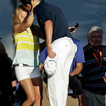Justin Rose, right, of England, gets a kiss from his wife Kate after putting on the 18th hole during the fourth round of the U.S. Open golf tournament at Merion Golf Club, Sunday, June 16, 2 …