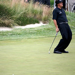 Phil Mickelson reacts after a missed putt on the fourth hole during the fourth round of the U.S. Open golf tournament at Merion Golf Club, Sunday, June 16, 2013, in Ardmore, Pa. (AP Photo/Mo …