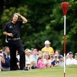 Phil Mickelson rubs his head before putting on the ninth hole during the fourth round of the U.S. Open golf tournament at Merion Golf Club, Sunday, June 16, 2013, in Ardmore, Pa. (AP Photo/M …