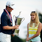 Justin Rose, left, of England, celebrates with his wife Kate after winning the U.S. Open golf tournament at Merion Golf Club, Sunday, June 16, 2013, in Ardmore, Pa. (AP Photo/Charlie Riedel)
