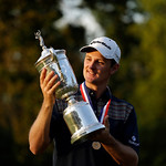 Justin Rose, of England, posses with the trophy after winning the U.S. Open golf tournament at Merion Golf Club, Sunday, June 16, 2013, in Ardmore, Pa. (AP Photo/Julio Cortez)