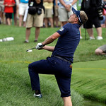 Luke Donald, of England, hits from a creek on the fourth hole during the fourth round of the U.S. Open golf tournament at Merion Golf Club, Sunday, June 16, 2013, in Ardmore, Pa. (AP Photo/M …