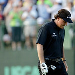 Phil Mickelson reacts after missing a shot on the 18th hole during the fourth round of the U.S. Open golf tournament at Merion Golf Club, Sunday, June 16, 2013, in Ardmore, Pa. (AP Photo/Jul …