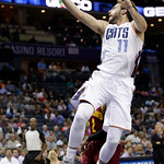 Charlotte Bobcats' Josh McRoberts (11) drives to the basket against the Cleveland Cavaliers during the first half of an NBA basketball game in Charlotte, N.C., Wednesday, April 17, 2013. (AP …