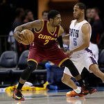 Cleveland Cavaliers' Kyrie Irving, left, drives against Charlotte Bobcats' Jannero Pargo, right, during the first half of an NBA basketball game in Charlotte, N.C., Wednesday, April 17, 2013 …