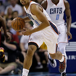 Charlotte Bobcats' Gerald Henderson brings the ball up the court against the Cleveland Cavaliers during the first half of an NBA basketball game in Charlotte, N.C., Wednesday, April 17, 2013 …