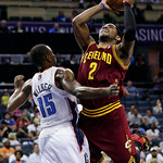 Cleveland Cavaliers' Kyrie Irving (2) shoots over Charlotte Bobcats' Kemba Walker (15) during the second half of an NBA basketball game in Charlotte, N.C., Wednesday, April 17, 2013. The Bob …