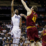 Charlotte Bobcats' Kemba Walker (15) shoots over Cleveland Cavaliers' Tyler Zeller (40) during the first half of an NBA basketball game in Charlotte, N.C., Wednesday, April 17, 2013. (AP Pho …
