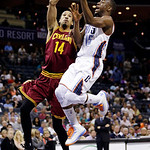 Charlotte Bobcats' Kemba Walker (15) drives past Cleveland Cavaliers' Shaun Livingston (14) during the first half of an NBA basketball game in Charlotte, N.C., Wednesday, April 17, 2013. (AP …