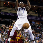 Charlotte Bobcats' Bismack Biyombo (0) dunks past Cleveland Cavaliers' Tristan Thompson (13) during the first half of an NBA basketball game in Charlotte, N.C., Wednesday, April 17, 2013. (A …
