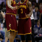 Cleveland Cavaliers' Dion Waiters, right, talks with Kevin Jones, left, during the second half of an NBA basketball game against the Charlotte Bobcats in Charlotte, N.C., Wednesday, April 17 …