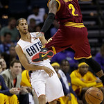 Charlotte Bobcats' Jannero Pargo, left, passes the ball past Cleveland Cavaliers' Kyrie Irving, right, during the second half of an NBA basketball game in Charlotte, N.C., Wednesday, April 1 …