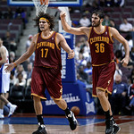 Cleveland Cavaliers forward Omri Casspi (36), of Israel, and center Anderson Varejao (17), of Brazil, celebrate a basket against the Detroit Pistons in the second half of an NBA basketball g …