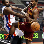 Detroit Pistons forward Jason Maxiell (54) and Cleveland Cavaliers guard Jeremy Pargo (8) vie for the ball in the first half of an NBA basketball game in Auburn Hills, Monday, Dec. 3, 2012. …