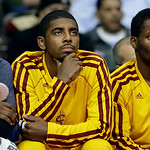 Cleveland Cavaliers guard Kyrie Irving (2) watches from the bench against the Detroit Pistons in the second half of an NBA basketball game in Auburn Hills, Mich., Monday, Dec. 3, 2012. Detro …