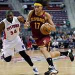 Cleveland Cavaliers center Anderson Varejao (17), of Brazil, drives on Detroit Pistons forward Jason Maxiell (54) during the first half of an NBA basketball game in Auburn Hills, Mich., Mond …