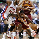 Detroit Pistons center Greg Monroe (10) tries to steal the ball from Cleveland Cavaliers guard Jeremy Pargo (8) in the second half of an NBA basketball game in Auburn Hills, Mich., Monday, D …