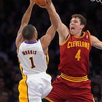 Los Angeles Lakers guard Darius Morris, left, puts up a shot as Cleveland Cavaliers forward Luke Walton defends during the second half of their NBA basketball game, Sunday, Jan. 13, 2013, in …