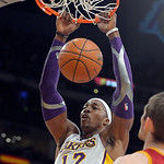 Los Angeles Lakers center Dwight Howard dunks as Cleveland Cavaliers center Tyler Zeller watches during the first half of an NBA basketball game, Sunday, Jan. 13, 2013, in Los Angeles. (AP P …