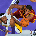 Los Angeles Lakers center Dwight Howard, left, puts up a shot as Cleveland Cavaliers forward Tristan Thompson defends during the first half of an NBA basketball game, Sunday, Jan. 13, 2013,  …