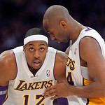 Los Angeles Lakers guard Kobe Bryant, right, chats with center Dwight Howard during the first half of the Lakers' NBA basketball game against the Cleveland Cavaliers, Sunday, Jan. 13, 2013,  …