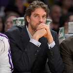 Los Angeles Lakers forward Pau Gasol, of Spain, watches from the bench during the first half of their NBA basketball game against the Cleveland Cavaliers, Sunday, Jan. 13, 2013, in Los Angel …
