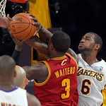 Cleveland Cavaliers guard Dion Waiters, center, goes up for a shot as Los Angeles Lakers forward Earl Clark defends during the first half of their NBA basketball game, Sunday, Jan. 13, 2013, …