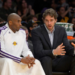 Los Angeles Lakers guard Kobe Bryant, left, chats with forward Pau Gasol, of Spain, as they watch from the bench during the first half of their NBA basketball game against the Cleveland Cava …