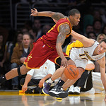 Cleveland Cavaliers forward Alonzo Gee, left, drives toward the basket as Los Angeles Lakers guard Steve Nash defends during the first half of an NBA basketball game, Sunday, Jan. 13, 2013,  …