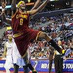 Cleveland Cavaliers guard C.J. Miles gets by Los Angeles Clippers forward Lamar Odom, rear, to the basket in the first half of an NBA basketball game, Monday, Nov. 5, 2012, in Los Angeles. ( …