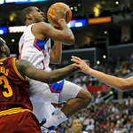 Cleveland Cavaliers guard Dion Waiters (3) and teammate center Anderson Varejao, right, double team Los Angeles Clippers guard Chris Paul as he drives to the basket in the second half of an …