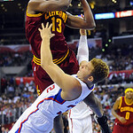 Cleveland Cavaliers forward Tristan Thompson (13) collides with Los Angeles Clippers forward Blake Griffin as he battles to the basket in the first half of an NBA basketball game, Monday, No …