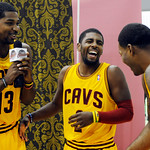 Cleveland Cavaliers forward Tristan Thompson (13) jokes with guard Kyrie Irving (2) and Alonzo Gee during their NBA basketball media day at the team's training facility in Independence, Ohio …